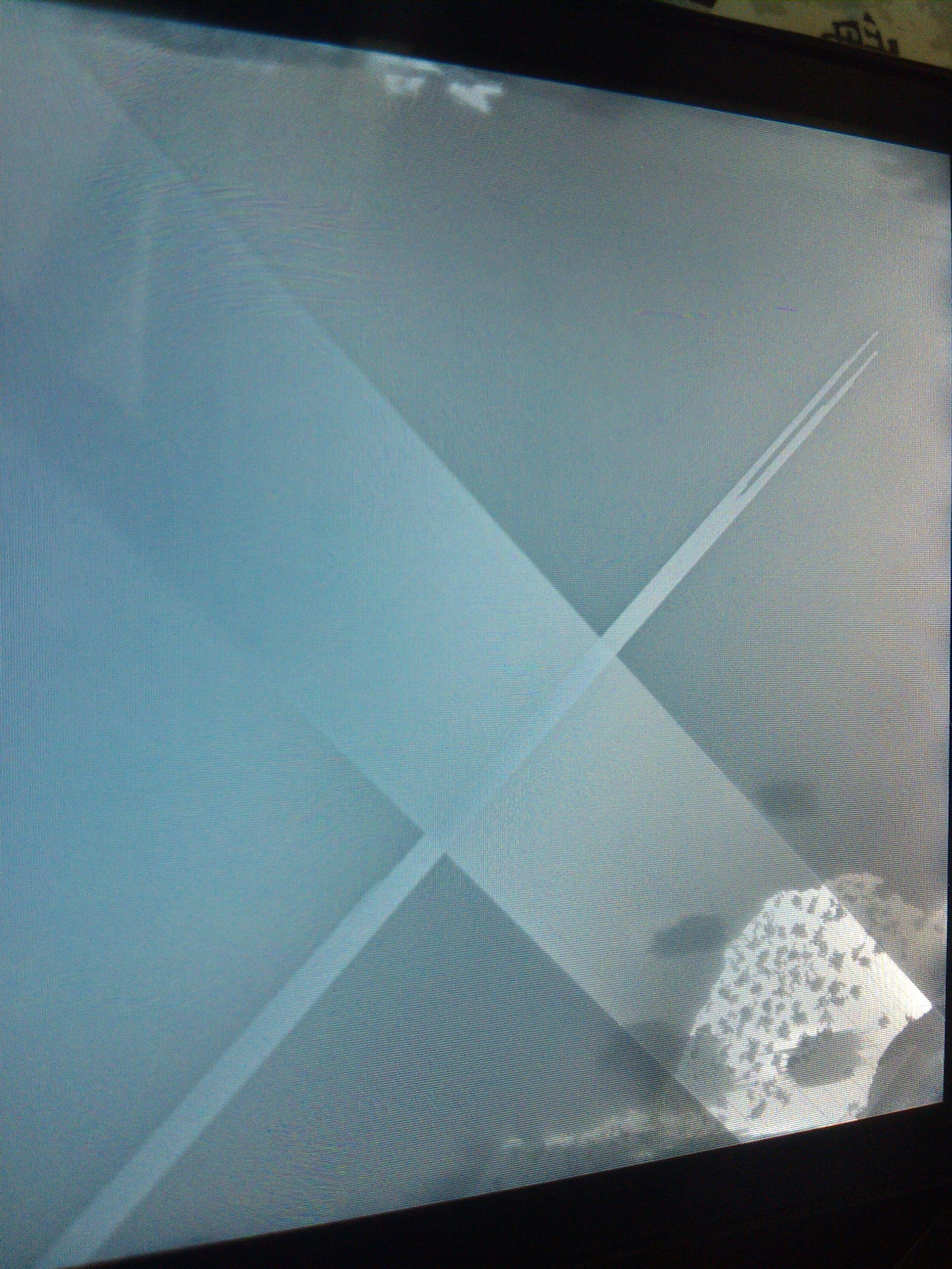 手机掉水里 拆机将机用冷风吹干后开机 发现液晶屏里有水高清图片