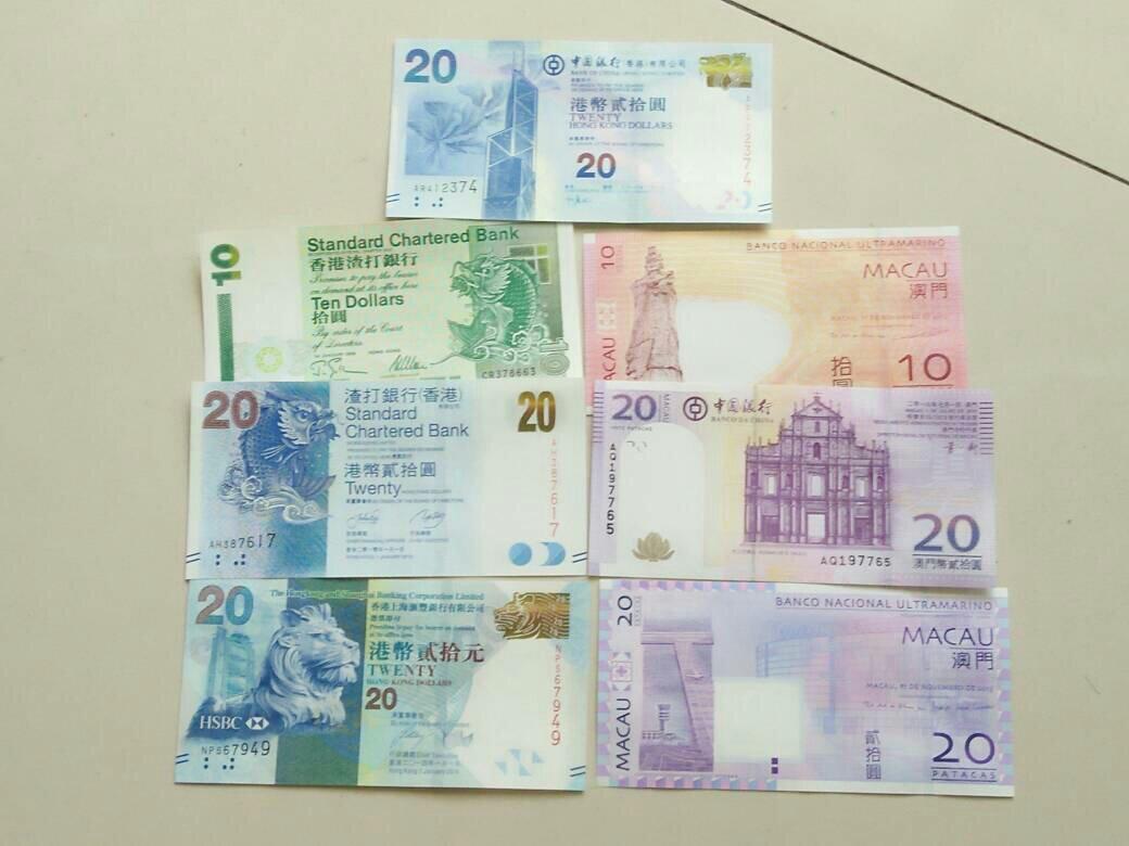 家里找到的香港澳门钱币.这个每种银行的钱币不一样,能一起花吗?