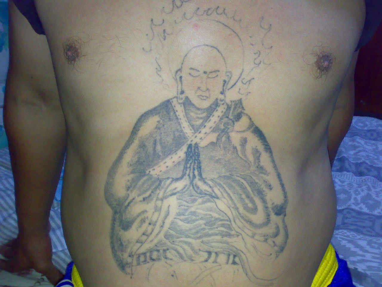 或者是在什么地方能找到,谢谢 这个纹身是未完成的,原图上还有一条龙图片
