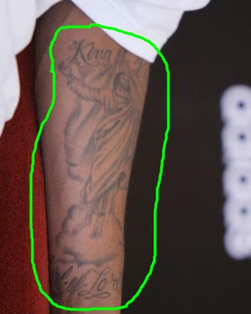 跪求!麦迪左手臂里那耶稣纹身全图图片